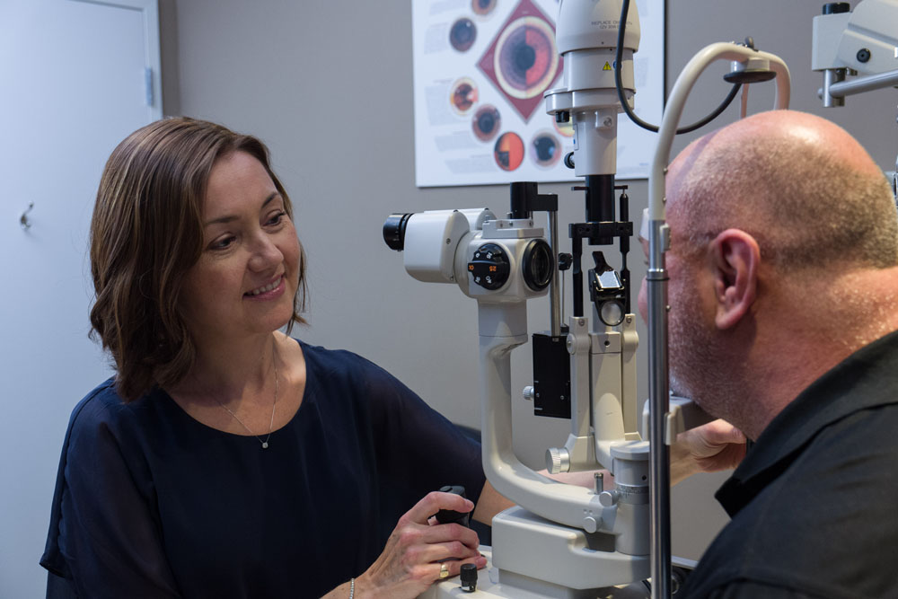 Dr. Moore performing an eye exam